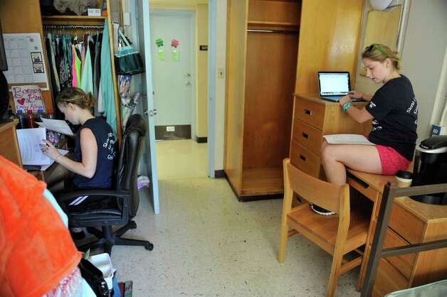 Freshmen, Allison Walters, left, from Phelps, and Natalia Fiorini from Saratoga Springs work updating their calendars with their class schedules as freshmen students moved in to their campus housing on Thursday, Aug. 28, 2014, in Loudonville, N.Y.  Walters and Fiorini are both taking part in the Bonner Service Leaders program at the college.  Those in the program volunteer eight to ten hours a week in the community and attend weekly meetings and training sessions.  After their four years the students will have volunteered 1800 hours.      (Paul Buckowski / Times Union) Photo: Paul Buckowski, Albany Times Union / 00028227A