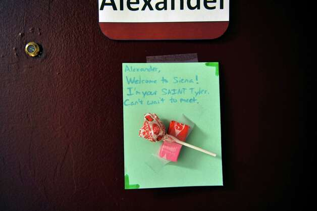 A note left for a students is seen on the dorm room door as freshmen students moved in to their campus housing on Thursday, Aug. 28, 2014, in Loudonville, N.Y.    (Paul Buckowski / Times Union) Photo: Paul Buckowski, Albany Times Union / 00028227A