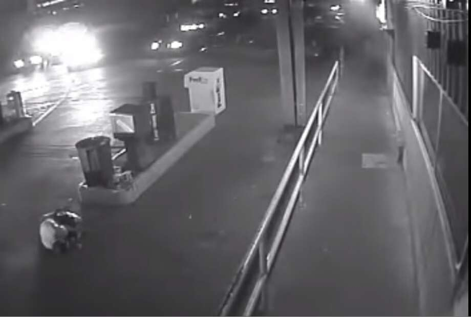 Laredo Police shot multiple times and killed Jose Walter Garza on August 30, 2014 outside a truckstop. Garza, who allegedly pointed a pellet gun at police, is shown in the screengrab of a surveillance video just after being shot by officers. Photo: Courtesy, Laredo Morning Times (via Screengrab)