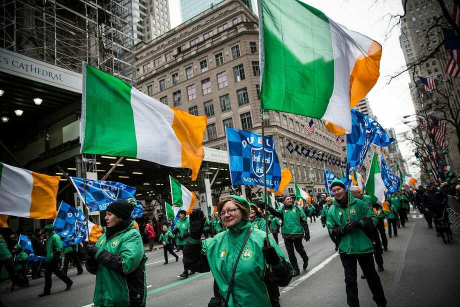 FILE - SEPTEMBER 3, 2014: It was announced that the New York City St. Patrick's Day Parade was lifting it's ban on gay groups, allowing them to march under their own banner September 3, 2014. NEW YORK, NY - MARCH 17:  Revelers march in the annual St. Patrick's Day Parade along Fifth Ave in Manhattan on March 17, 2014 in New York City. Political controversy surrounded this year's parade, as New York City Mayor Bill De Blasio decided not to march due to the parade organizer's policy to ban participants that identify themselves as lesbian, gay, bisexual or transgender.  Heineken and Guinness announced earlier that they would drop their sponsorship of the parade for along the same reasons. (Photo by Andrew Burton/Getty Images) Photo: Andrew Burton, Getty Images