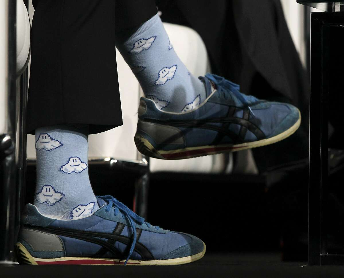 Aaron Levie, CEO and co-founder of Box, wears cloud socks while delivering a keynote speech at the cloud storage company's BoxWorks conference in San Francisco, Calif. on Wednesday, Sept. 3, 2014.