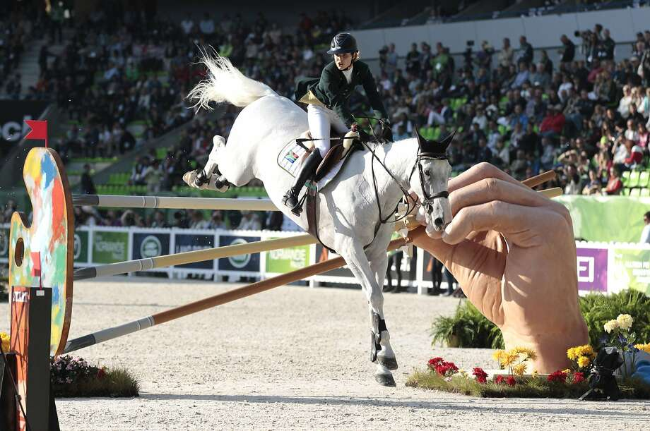 The art of jumping:South African Cara Bianca Frew rides a horse named Leopold Pierreville in the Individual Jumping competition of the FEI World Equestrian Games in Caen, France. Photo: Charly Triballeau, AFP/Getty Images