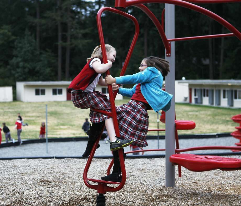 Twist and shout: Lauriane Molamphy (left) and Timmarra Argeris monkey around on the people bars before the morning 