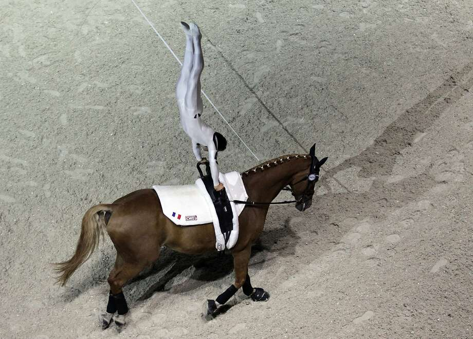 Tall in the saddle:France's Nicolas Andreani rides Just a Kiss HN the hard way in the Individual Men's Vaulting Compulsory at the FEI World Equestrian Games in Caen. Photo: Charly Triballeau, AFP/Getty Images