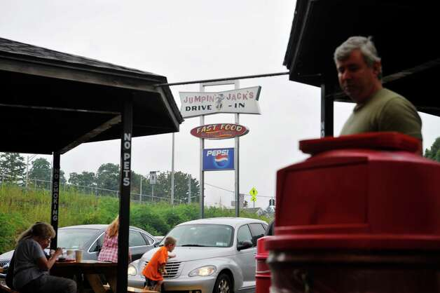 Customers gather for the final day of the season at Jumpin Jack's Drive-In on Sunday, Aug. 31, 2014, in Scotia, N.Y.    (Paul Buckowski / Times Union) Photo: Paul Buckowski, Albany Times Union / 10028401A