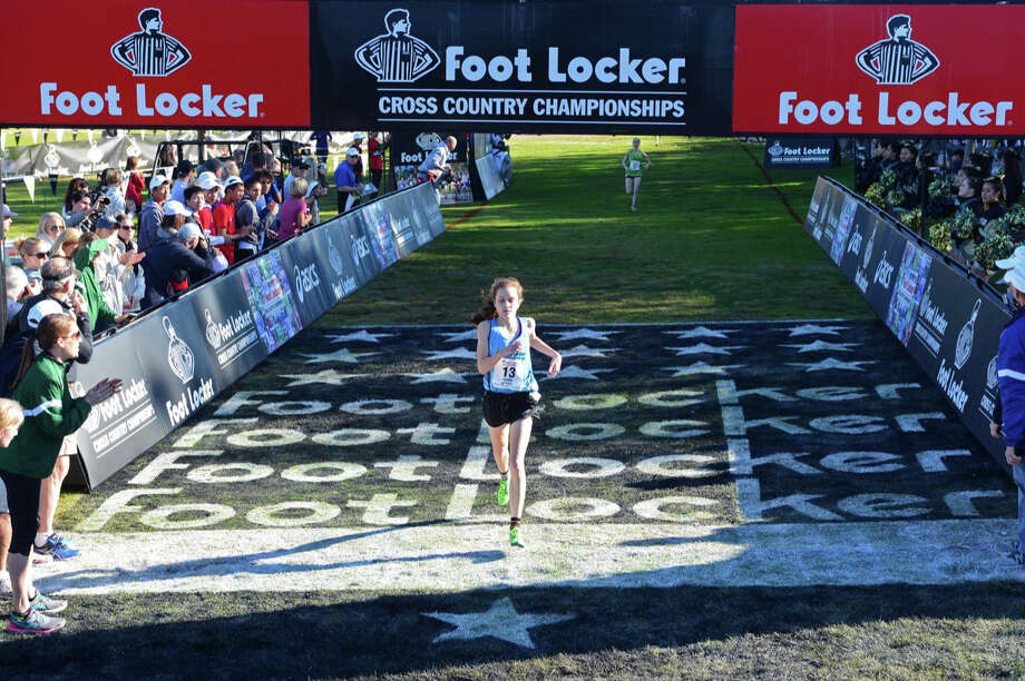 Hannah DeBalsi crosses the finish line at the 2013 Footlocker Cross Country Finals San Diego on December 14, 2013. DeBalsi finished in second place, earning All-American honors. Photo: Bruce Wodder, Photo: Bruce Wodder / Westport News Contributed