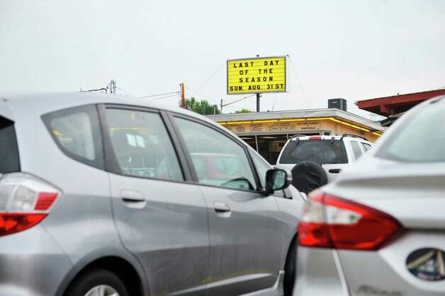 The parking lot is full during the final day of the season at Jumpin Jack's Drive-In on Sunday, Aug. 31, 2014, in Scotia, N.Y.    (Paul Buckowski / Times Union) Photo: Paul Buckowski, Albany Times Union / 10028401A
