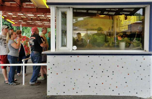 People line up to order food as employees fill orders during the final day of the season at Jumpin Jack's Drive-In on Sunday, Aug. 31, 2014, in Scotia, N.Y.    (Paul Buckowski / Times Union) Photo: Paul Buckowski, Albany Times Union / 10028401A