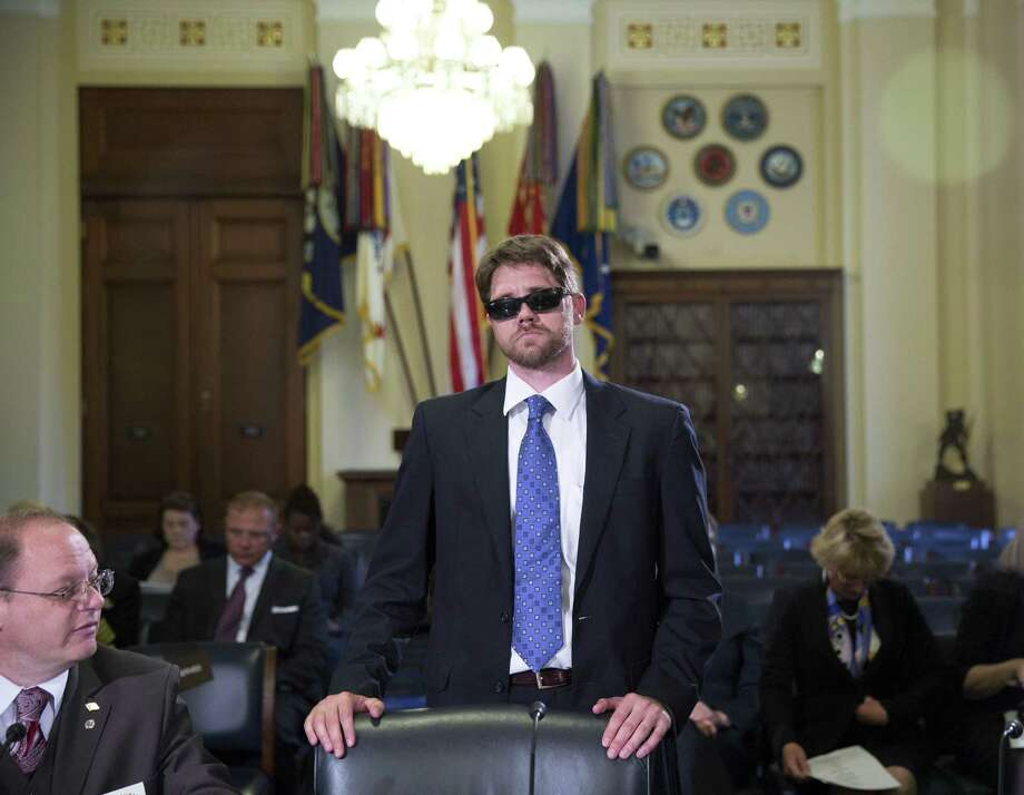 Travis Fugate, an Army veteran who lost his vision in Iraq, appears before a House Veterans Affairs oversight panel   this year. A reader says the administration and the VA must be held accountable. Photo: Doug Mills / New York Times / NYTNS