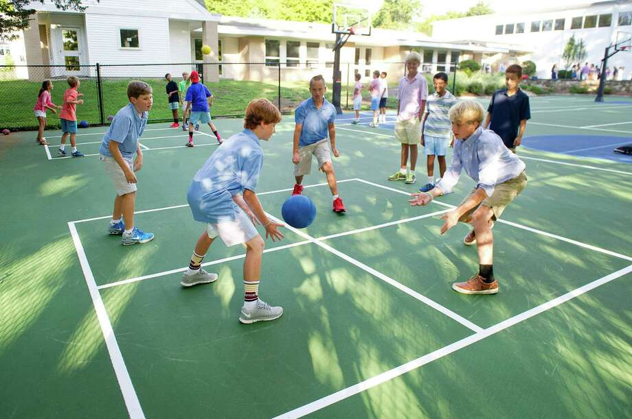 "Students play foursquare on the newly redesigned and resurfaced basketball court, named ""Kyle's Court"" in memory of Kyle Markes, at New Canaan Country School on Tuesday, September 3, 2014. Photo: Lindsay Perry / Stamford Advocate"