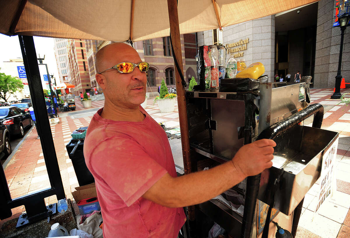 """Jimmy Nigretti runs his """"Jimmy Does the Best"""" hot dog stand on Church Street in downtown New Haven, Conn. on Wednesday, September 3, 2014. Nigretti said that high profile trials like the current John Rowland trial at neighboring federal court don't affect his business."""