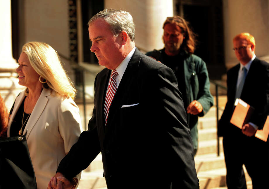 With wife Patty Rowland, left, former Governor John Rowland exits federal court in New Haven, Conn. on Wednesday, September 3, 2014. Rowland is on trial on seven charges including conspiracy and obstruction of justice. Photo: Brian A. Pounds / Connecticut Post