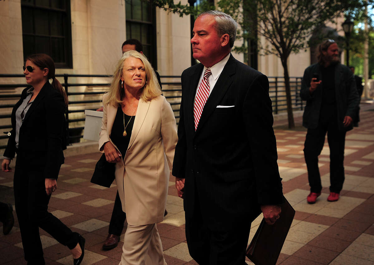 With wife Patty Rowland, left, former Governor John Rowland exits federal court in New Haven, Conn. on Wednesday, September 3, 2014. Rowland is on trial on seven charges including conspiracy and obstruction of justice.