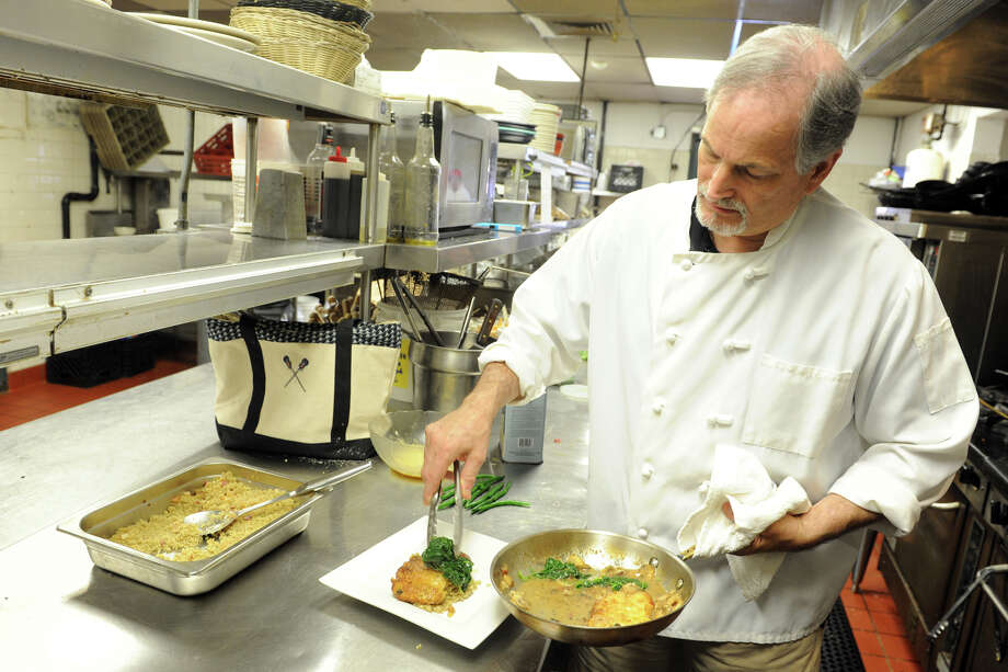 Tom Devine plates a sautéed chicken cutlet, part of the fall menu at Two Steps Downtown Grille, in Danbury, Conn., Sept. 3, 2014. Photo: Ned Gerard / Connecticut Post