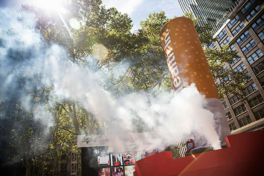 A 50-foot cigarette getting put out in New York's Bryant Park helps CVS publicize its change. Photo: Andrew Burton, Getty Images