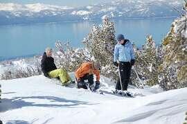 Skiiers at Mount Rose, NV look over Lake Tahoe.