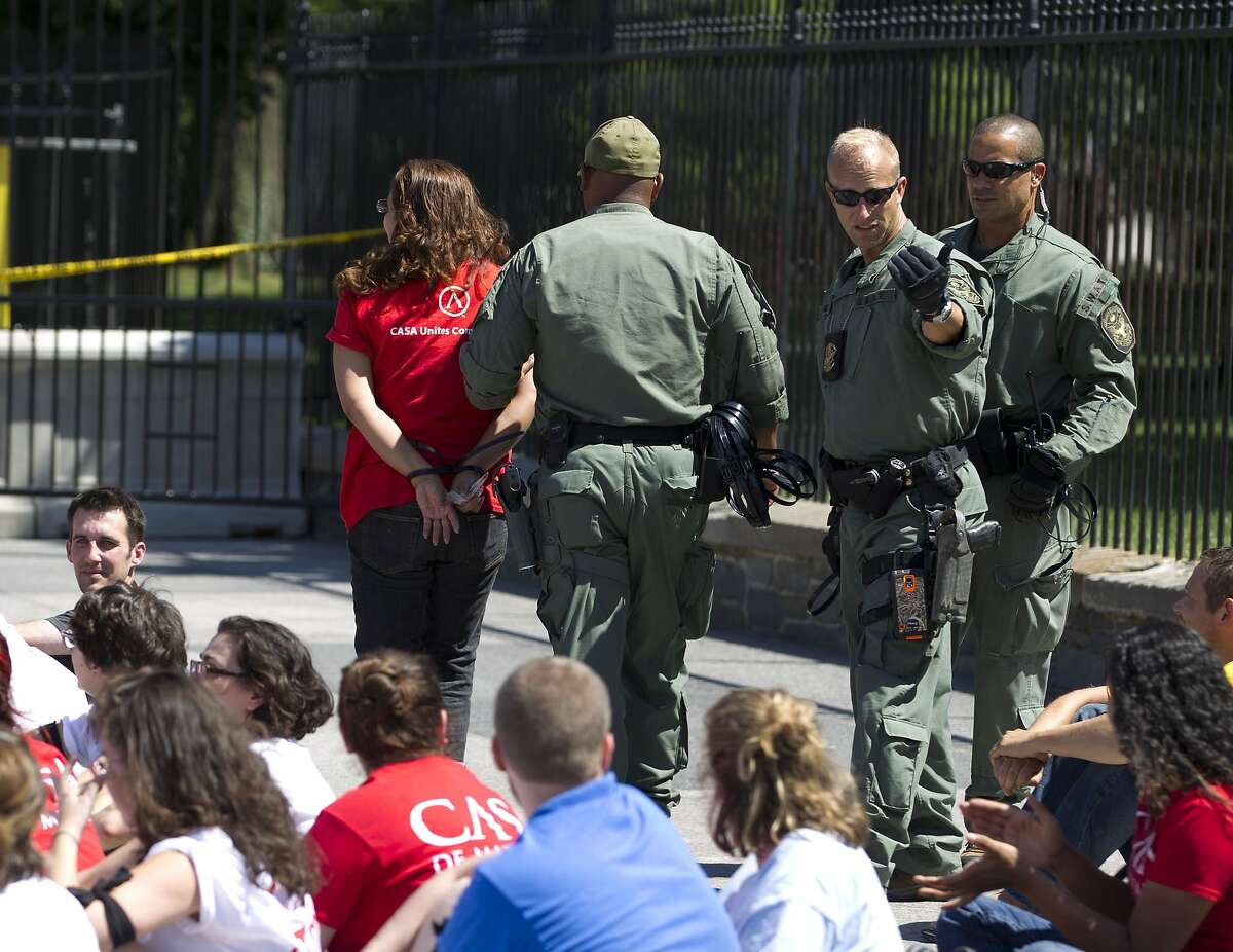 Protesters are arrested outside the White House last week at a rally over deporting migrants.