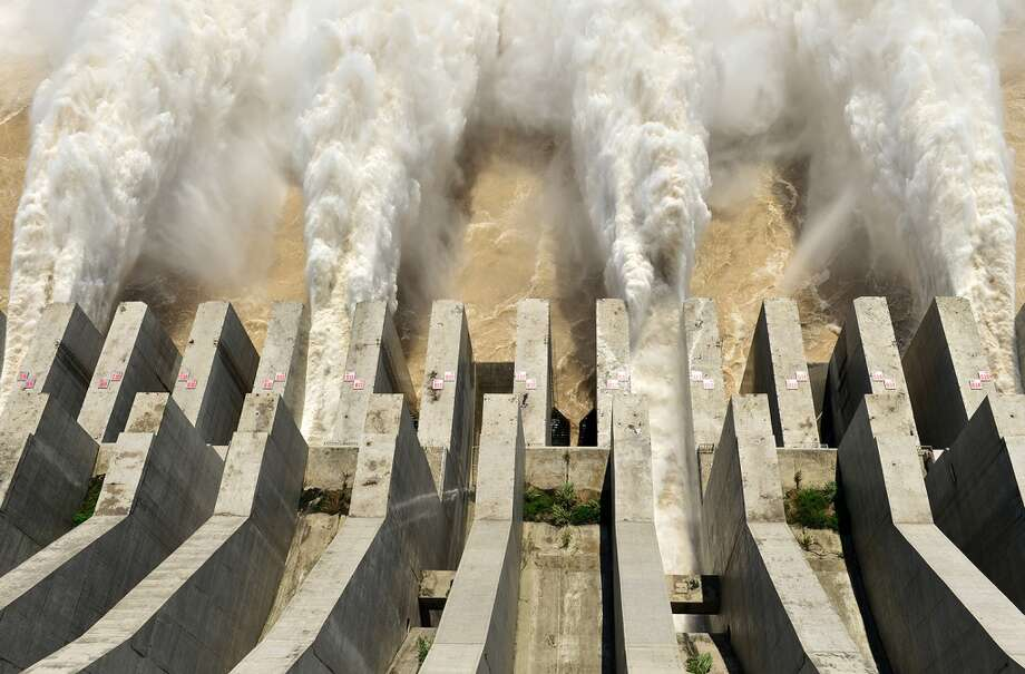 Three Gorges Reservoir releases flood waters for the first time on September 3, 2014 in Yichang, Hubei province of China. Three Gorges Reservoir reached its flood peak on September 2. Photo: ChinaFotoPress, ChinaFotoPress Via Getty Images