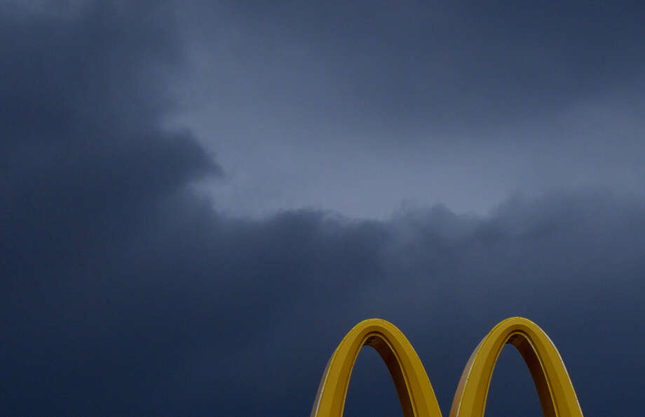 Rain clouds loom over McDonald's arches  at Loop 410 at Culebra on Wednesday, Sept. 3, 2014. Photo: Billy Calzada, San Antonio Express-News /  San Antonio Express-News