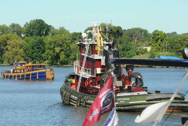 Tugboats gather in the Port of Albany to parade up the Hudson River toward Waterford in the annual tug parade on Friday Sept. 6, 2013 in Albany, N.Y. (Michael P. Farrell/Times Union) Photo: Michael P. Farrell / 00023773A