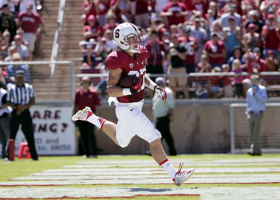 Freshman tailback Christian McCaffrey scores a 52-yard touchdown against UC Davis in his first game for Stanford. Photo: Marcio Jose Sanchez, Associated Press
