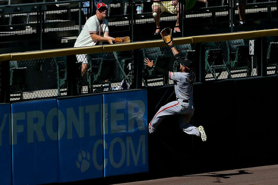 Left fielder Gregor Blanco runs out of room to catch Nolan Arenado's fifth-inning homer, one of four off Ryan Vogelsong. Photo: Justin Edmonds, Getty Images