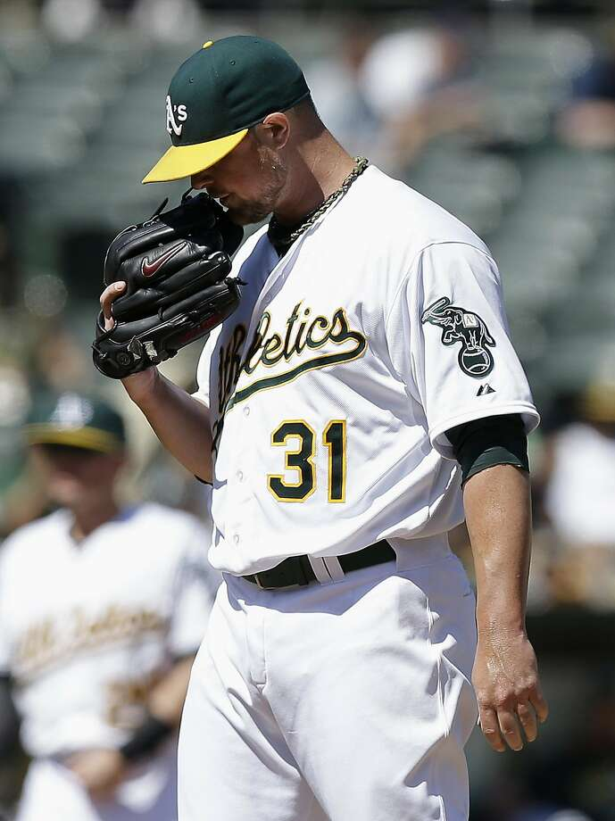 Jon Lester limited Seattle to two runs in eight innings but was tagged with the loss. Photo: Jeff Chiu, Associated Press