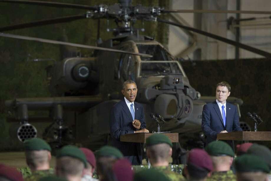 President Barack Obama, standing near Prime Minister Taavi Roivas of Estonia, addresses U.S. and Estonian troops in Tallinn, Estonia. Photo: Saul Loeb / Getty Images / AFP