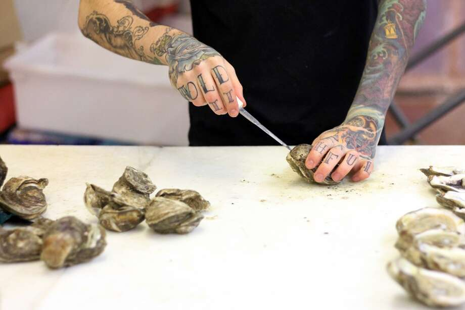 How to shuck oysters? Photo: Bria Webb, Associated Press