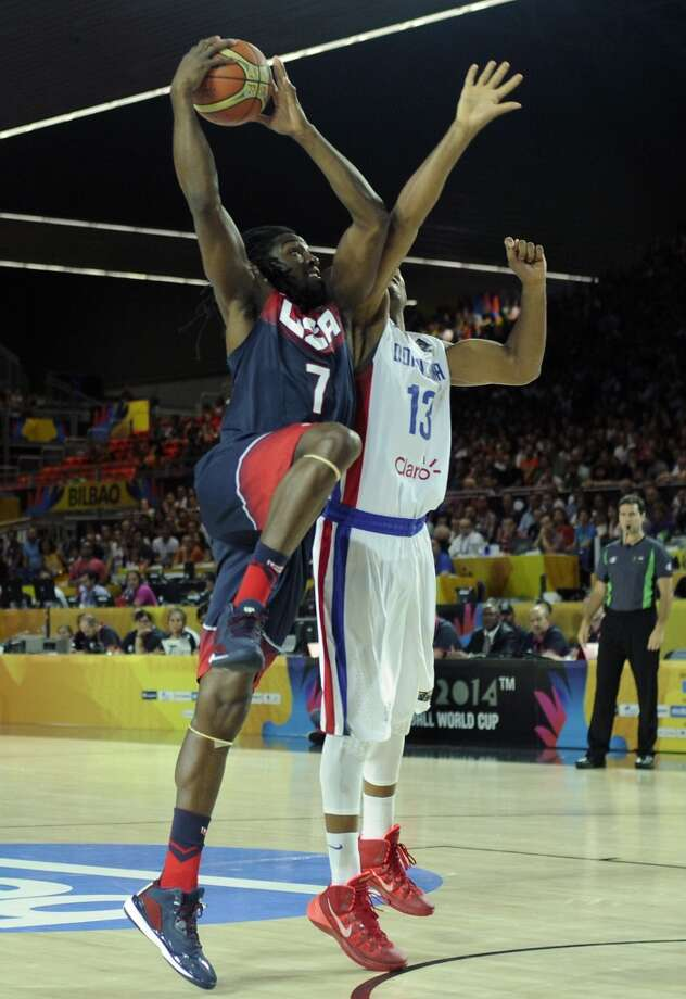 US forward Kenneth Faried (L) vies with Dominican Republic's forward Eulis Baez (R) during the 2014 FIBA World basketball championships group C match Dominican Republic vs USA at the Bizkaia Arena in Bilbao on September 3, 2014. AFP PHOTO / ANDER GILLENEAANDER GILLENEA/AFP/Getty Images Photo: AFP/Getty Images