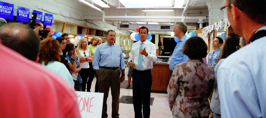 Gov. Dannel Malloy, center, stopped by to address supporters at the new Westport Democratic headquarters Wednesday. Photo: Genevieve Reilly / Fairfield Citizen