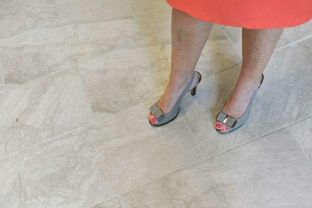 Linda Hillman, president of the Rensselaer County Regional Chamber of Commerce, stands on the marble floor, made to match the exterior, in the entryway on Wednesday, Sept. 3, 2014, at the Proctor Building in Troy, N.Y. (Cindy Schultz / Times Union) Photo: Cindy Schultz / 00028431A