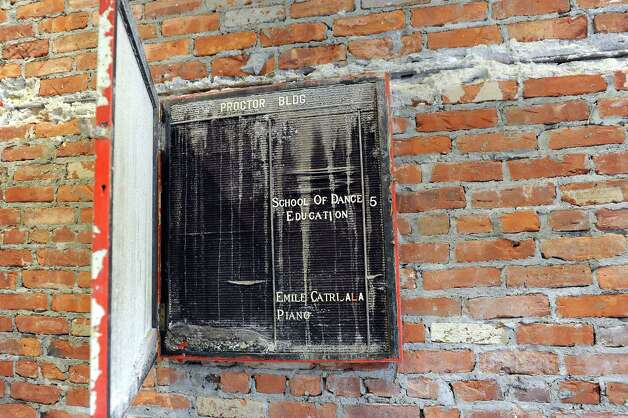 The original announcement board remains intact on Wednesday, Sept. 3, 2014, at the Proctor Building in Troy, N.Y. (Cindy Schultz / Times Union) Photo: Cindy Schultz / 00028431A