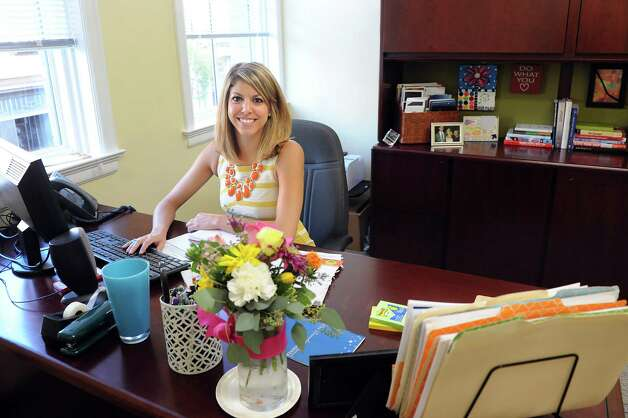 Kate Ollier, director of member engagement and events, in her new office in the Rensselaer County Regional Chamber of Commerce on Wednesday, Sept. 3, 2014, at the Proctor Building in Troy, N.Y. (Cindy Schultz / Times Union) Photo: Cindy Schultz / 00028431A