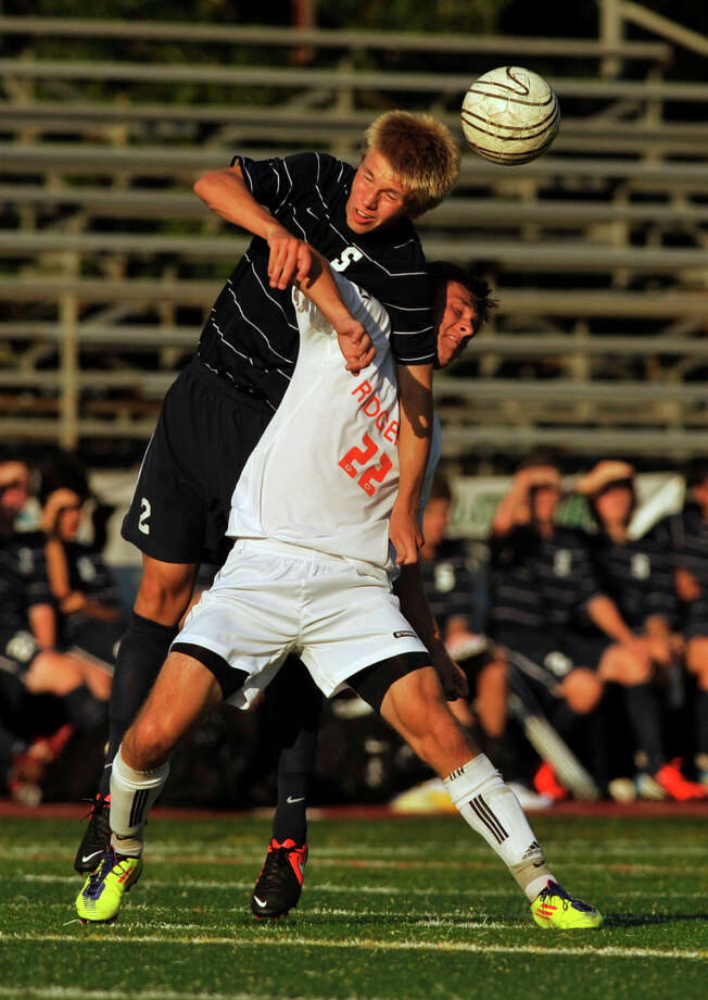 Staples' Andrew Puchala Ridgefield's Kent Coleman battle for possession of the ball during their game at Ridgefield High School on Thursday, Sept. 13, 2012. Ridgefield won, 2-1. Photo: Jason Rearick / The News-Times