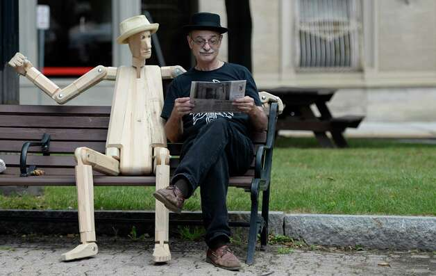 Peter Leue, Designer Craftsman sits with Poser #1, one of his interactive sculptures at the art fair in Tricentennial Park Wednesday afternoon Sept. 3, 2014 in Albany, N.Y.  The Artfair will continue every Wednesday during the month of September.    (Skip Dickstein/Times Union) ORG XMIT: MER2014090314161414 Photo: SKIP DICKSTEIN / 00028200A