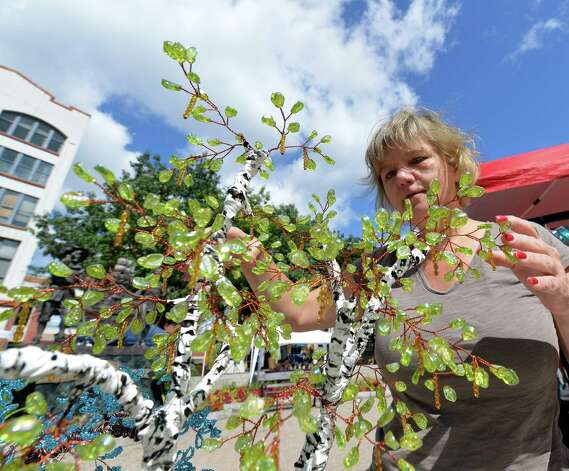 Lucy Fraser shows shows her beaded wire tree and flower sculpture pieces at the art fair in Tricentennial Park Wednesday afternoon Sept. 3, 2014 in Albany, N.Y.  The Artfair will continue every Wednesday during the month of September.    (Skip Dickstein/Times Union) Photo: SKIP DICKSTEIN / 00028200A