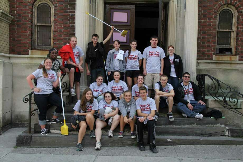 Students from the College of Saint Rose volunteered at Grand Street Arts Center in Albany during last year's Reach Out Saint Rose day of community service. The center was one of 50 local organizations to receive assistance. (Photo courtesy of Ben Marvin)