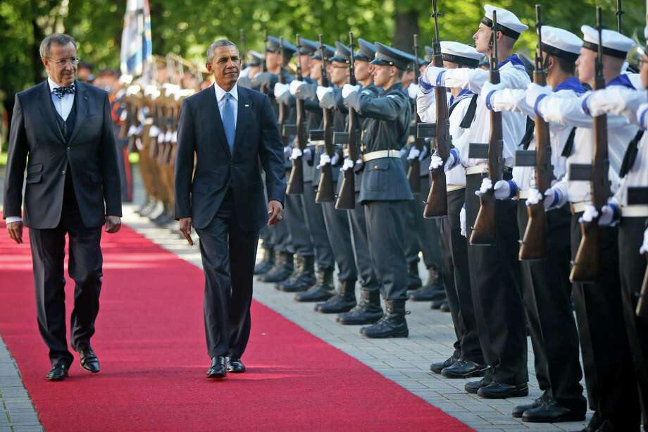 U.S. President Barack Obama and with Estonian President Toomas Hendrik Ilves review the honor guard at Kadriorg Palace in Tallinn, Estonia, Wednesday, Sept. 3, 2014. Obama is in Estonia for a one day visit where he will meet with Baltic State leaders before heading to the NATO Summit in Wales. (AP Photo/Charles Dharapak) ORG XMIT: ESTD103 Photo: Charles Dharapak / AP