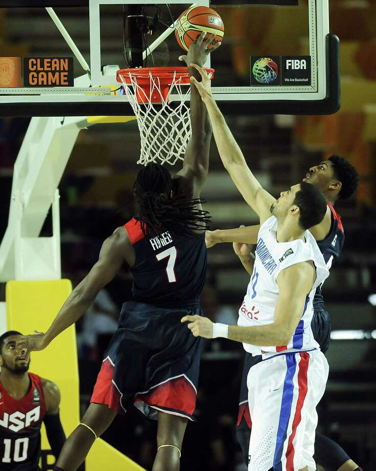 Kenneth Faried (left) goes up for a basket against the Dominican Republic's Eloy Vargas (right). Faried led the United States, which improved to 4-0 in the Basketball World Cup, to 16 points. Photo: Ander Gillenea / Getty Images / AFP