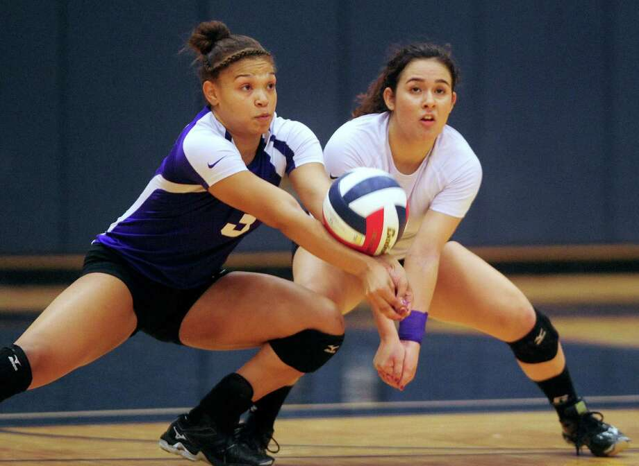 Brittany Lawson, left, and Lauren Jarrell of Warren return a ball during District 27-6A volleyball action against O'Connor at the Paul Taylor Fieldhouse on Wednesday, Sept. 3, 2014. Photo: Billy Calzada, San Antonio Express-News / San Antonio Express-News