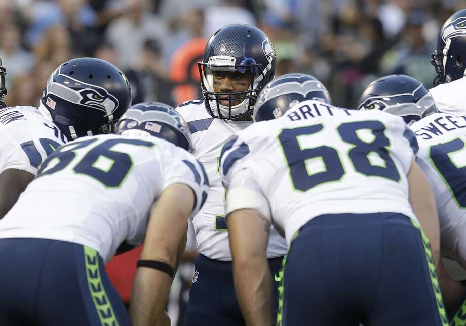 1. A thin line between love and hate Seattle's much-maligned offensive line went through a makeover in the offseason, allowing incumbent starters Breno Giacomini and Paul McQuistan to walk. In their places, the team will start rookie second-round pick Justin Britt and former first-rounder James Carpenter at right tackle and left guard, respectively. They — along with returning starters in left tackle Russell Okung, center Max Unger and right guard J.R. Sweezy — will be tasked with protecting Russell Wilson against what should be a ferocious Green Bay pass rush, led by outside linebackers Clay Matthews (50 career sacks) and the newly acquired Julius Peppers (119). If the line holds, Wilson could have a field day against a suspect Packers secondary. If they don't, Wilson may need to display his trademark elusiveness early and often. Photo: Jeff Chiu, Associated Press