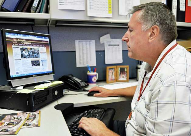 Overseeing the district's communications, John Noetzel works on their website Tuesday at the South Colonie Schools district office Sept. 2, 2014, in Colonie, NY.  (John Carl D'Annibale / Times Union) Photo: John Carl D'Annibale / 00028403A