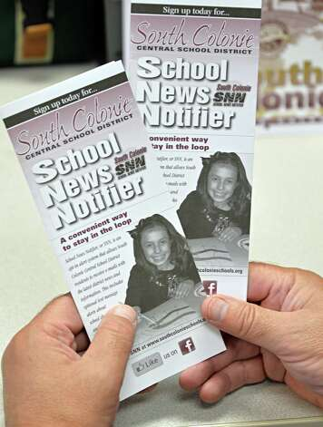 Overseeing the district's communications, John Noetzel with their Scholol News Notifier brochures Tuesday at the South Colonie Schools district office Sept. 2, 2014, in Colonie, NY.  (John Carl D'Annibale / Times Union) Photo: John Carl D'Annibale / 00028403A