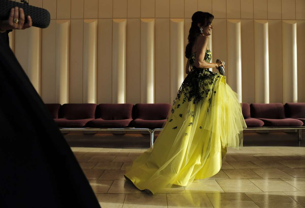 Komal Shah walks to the dining room as dinner is served at the San Francisco Symphony Gala at Davies Symphony Hall in San Francisco, Calif., on Wednesday, September 3, 2014.