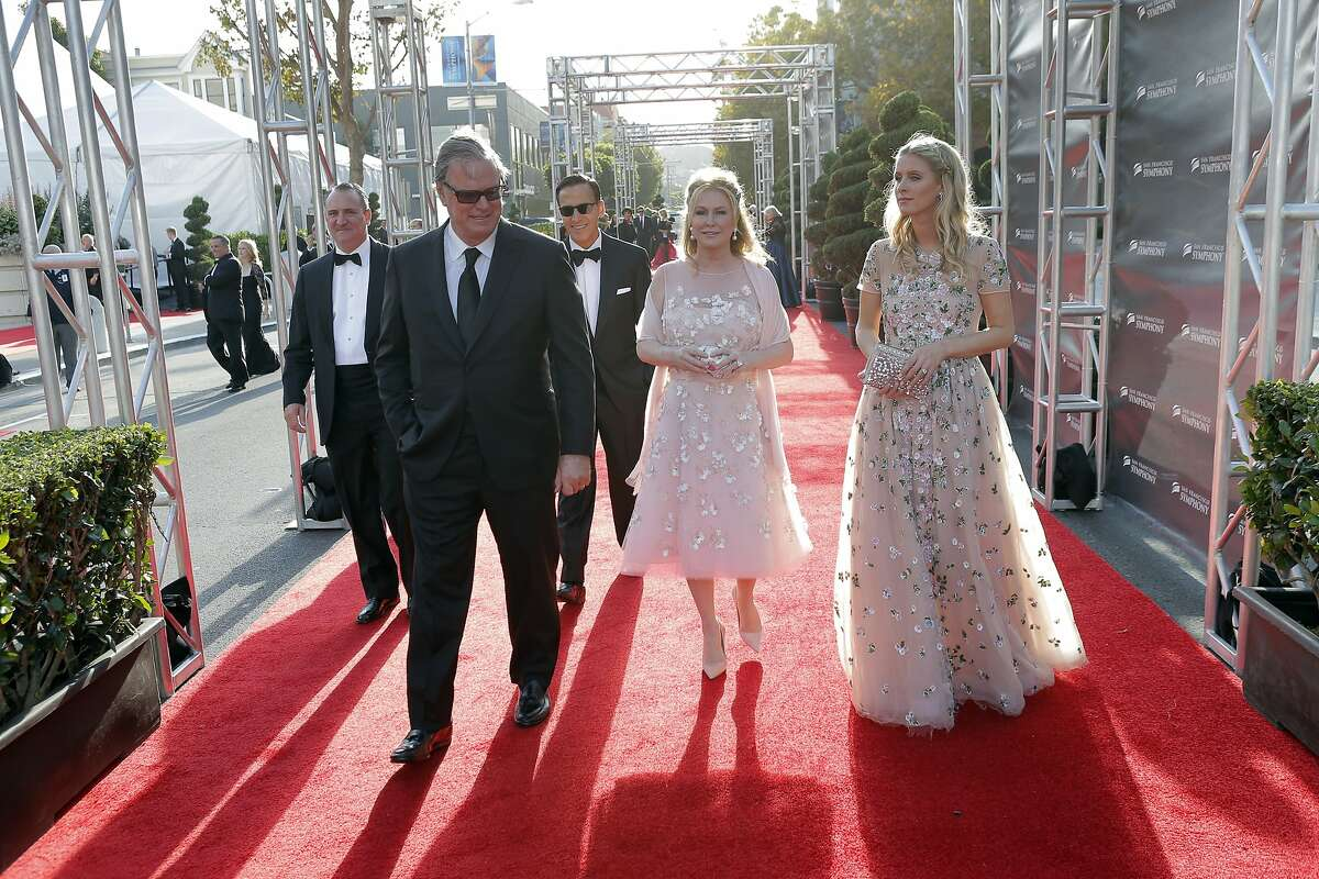 Nicky Hilton, right walks with her parents Richard Hilton, left, and Kathy Hilton, center, at the San Francisco Symphony Gala at Davies Symphony Hall in San Francisco, Calif., on Wednesday, September 3, 2014.