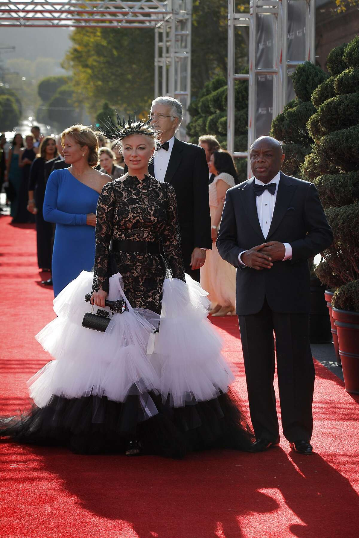 Former San Francisco Mayor, Willie Brown, right, arrives on the red carpet with Sonya Molodetskaya, left, at the San Francisco Symphony Gala at Davies Symphony Hall in San Francisco, Calif., on Wednesday, September 3, 2014.