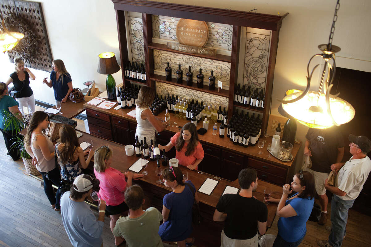 Mandy Raught serves guests at the Jeremy Wine Co. in downtown Lodi, where tasting-room culture draws throngs of visitors.