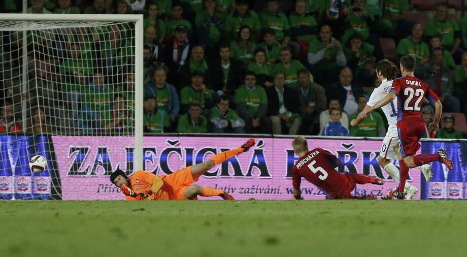 Alejandro Bedoya (in white) scores past Czech Republic goalkeeper Petr Cech in the first half of the United States' win in Prague. It was the Americans' first game since the World Cup. Photo: Matej Divizna / Getty Images / 2014 Getty Images