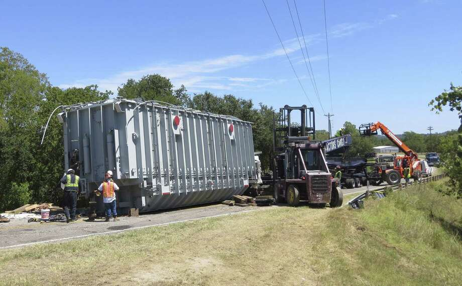 A 720,000-pound transformer came off its transport vehicle on Aug. 22, just 4 miles from its destination, an electrical substation in Comfort. As the equipment resumes its journey, officials are concerned about the weight capacity of a nearby bridge. Photo: Zeke MacCormack, San Antonio Express-News / San Antonio Express-News